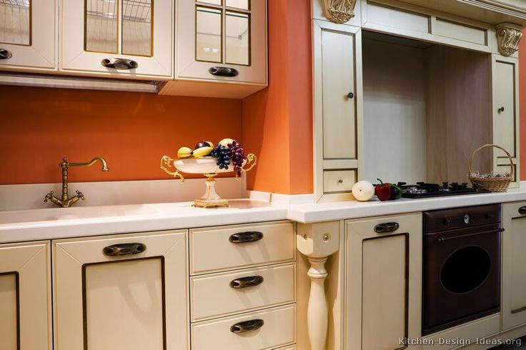 Traditional antique white kitchen cabinets kitchen for Antique ivory kitchen cabinets