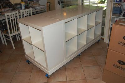 """2 Ikea Expedit (2x4 cubes) back to back and one Expedit (2x2 cubes) on end, board on bottom with casters, board on top (not shown) 