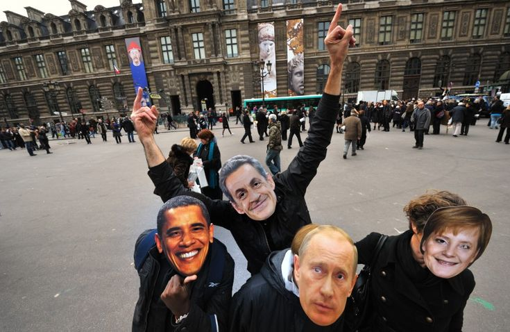 Activists from CCFD Terre Solidaire (Catholic Committee against Hunger and for Development) wear masks portraying US President Barack Obama, France's President Nicolas Sarkozy, Russia's Prime Minister Vladimir Putin and German Chancellor Angela Merkel during a protest action at the Palais Royal place in Paris, France. (Reuters)