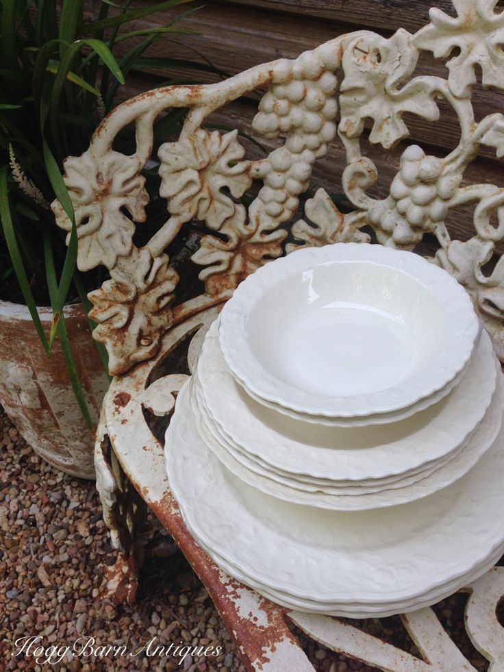 Vintage White Ironstone Dishes on Antique Chippy White Cast Iron Bench Seat in the Garden Hogg Barn Antiques