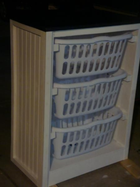 Fabulous, cheap, and easy basket dresser could be used for dirty clothes, for knick knacks, tools, craft items.  Possibilities are endless.