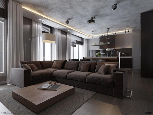 The plush living room sofa contrasts with the otherwise clean lines of most of the apartment while still staying true to the monochromatic t...