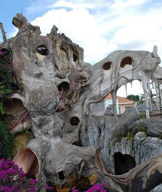 "Hang Nga Guesthouse, Dalat, Vietnam  Mushrooms, spiderwebs, portholes, and tree roots are sculpted into the organic concrete form, and each of the 10 guest rooms at ""The Crazy House"" is named for an animal.>>> I want to stay here!!"
