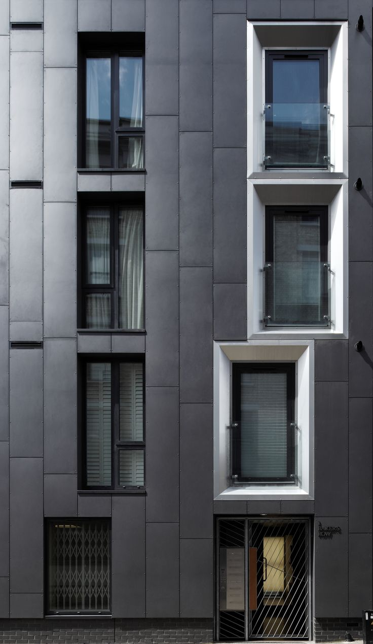 Anthracite EQUITONE facade panels in Bakers Row, London. #architecture #material…