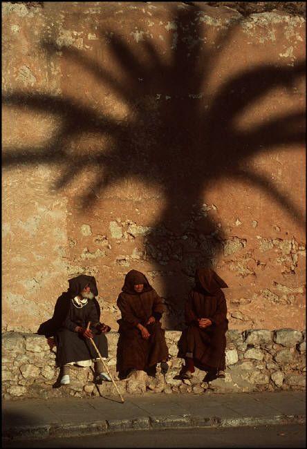 Essaouira. Men wearing traditional hand woven outcoats