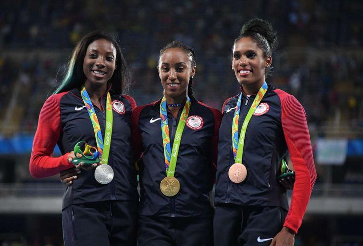 Brianna Rollins won gold, Nia Ali captured silver and Kristi Castlin grabbed bronze in the women's 100-meter hurdles.