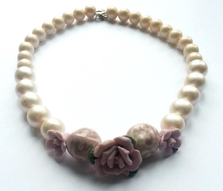 Handmade necklace created with ceramic roses and pink pearls.    www.facebook.com/SimplicitybyMelanie