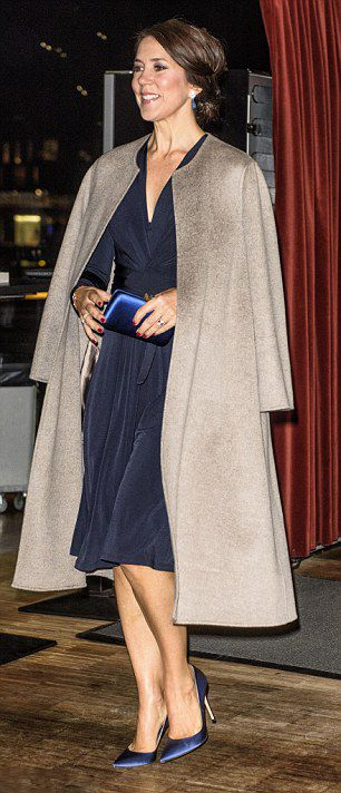 Crown Princess Mary of Denmark wear the Issa silk jersey wrap dress with matching navy blue pointed pumps, drop earrings and a royal blue clutch.  She also wore her grey JOSEPH Double Cashmere Oslo Coat.