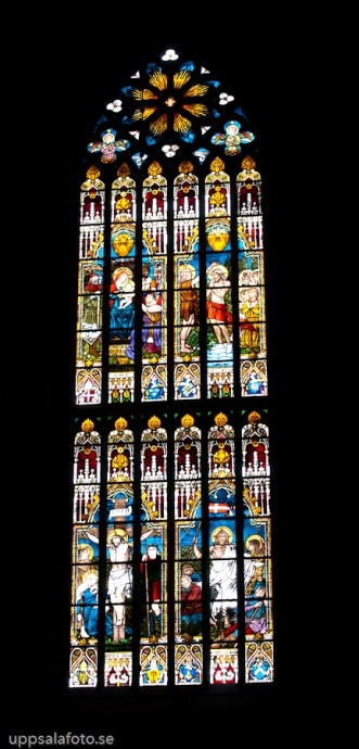 A stained glass window in the Uppsala Cathedral (Swedish: Uppsala domkyrka) a Gothic style cathedral located centrally in the city of Uppsala, Sweden. Start of construction dates back to the late 13th century. The cathedral was inaugurated in 1435.