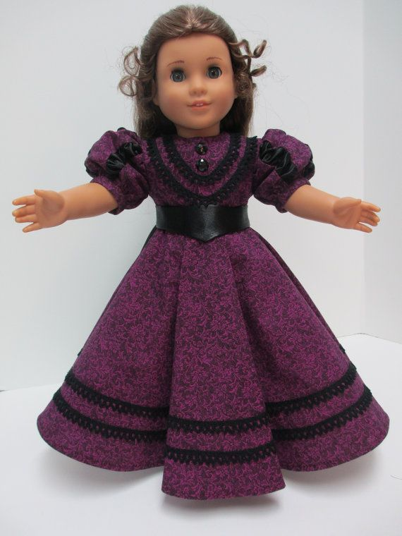 In 1889 the bustle began to fade. Gathers in the back of the skirt remained and sleeves began to grow larger. This dress has a balloon sleeve with black ruching inserts of crepe backed satin. The dress is made of a very good cotton fabric that washes up beautifully. The tapestry print is a bright magenta on darker magenta. It even has a texture to it. In this time period, skirts became flared and gored, even circular. This skirt is made of 7 gored A line sections. It has a pleat in the…