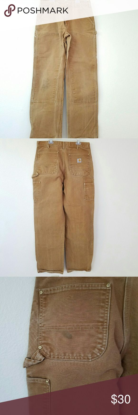 CARHARTT Pants Classic men's Carhartts. Good condition except 2 spots as shown in photo 3 and 4. Made in the USA, these will last for years. Size 33/32 Carhartt Pants