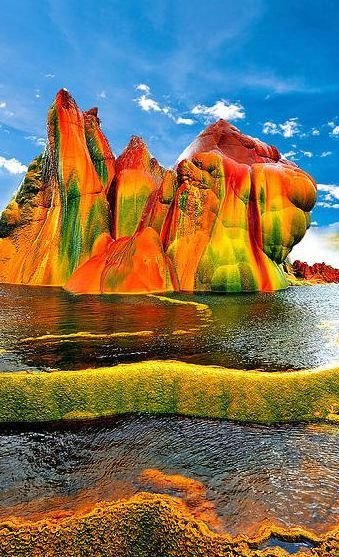 Fly Geyser, Northern Nevada. An accidental man made phenomenon that has made it one of the most colorful places in the world. Discover 74 other places so colorful it's hard to believe they're real. Click through on the picture to get your mind blown!