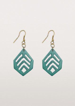 Bold and beautiful in bone! Expertly cut into a stunning geometric leaf shape. Turquoise fresh.
