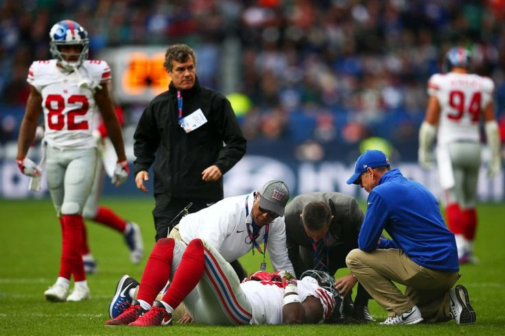 Giants vs. Rams in London:     October 23, 2016  -   17-10, Giants  -  Dwayne Harris #17 of the New York Giants receives treatment for an injury during an NFL game between the New York Giants and the Los Angeles Rams at Twickenham Stadium in London, Sunday Oct. 23, 2016.