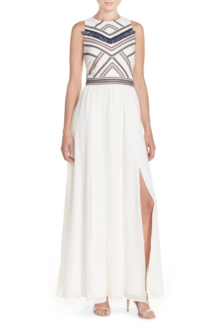 Crushing on the embroidered detailing of this dress that offsets the airy chiffon maxi skirt of this unique dress.