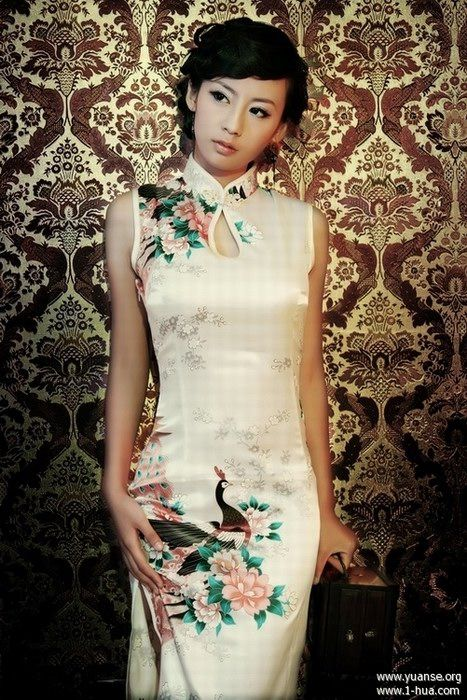 My qipao is like this with the peacock, a white one would be nice
