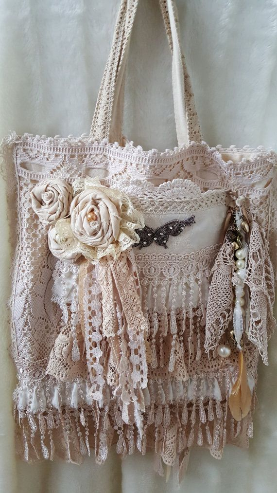 This is a shabby lace tote bag.This is a canvas bag that i have covered in lots of vintage lace and vintage doilies.I have added some handmade