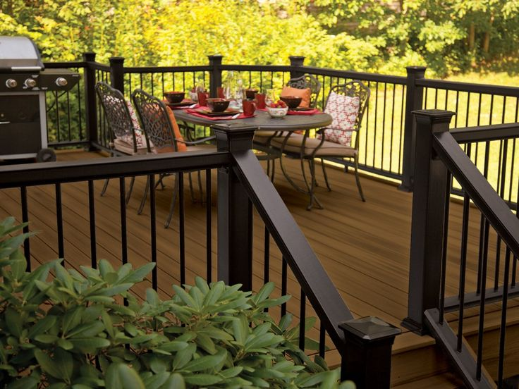 Pro-Tect decking in Chestnut with Mission rail in black and metal balusters