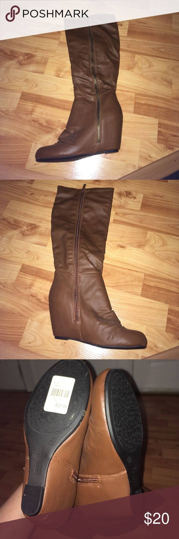 Camel Wedge Boots Camel Wedge Boots / never worn but was bought with patches on back of one (see pic) Shoes Heeled Boots