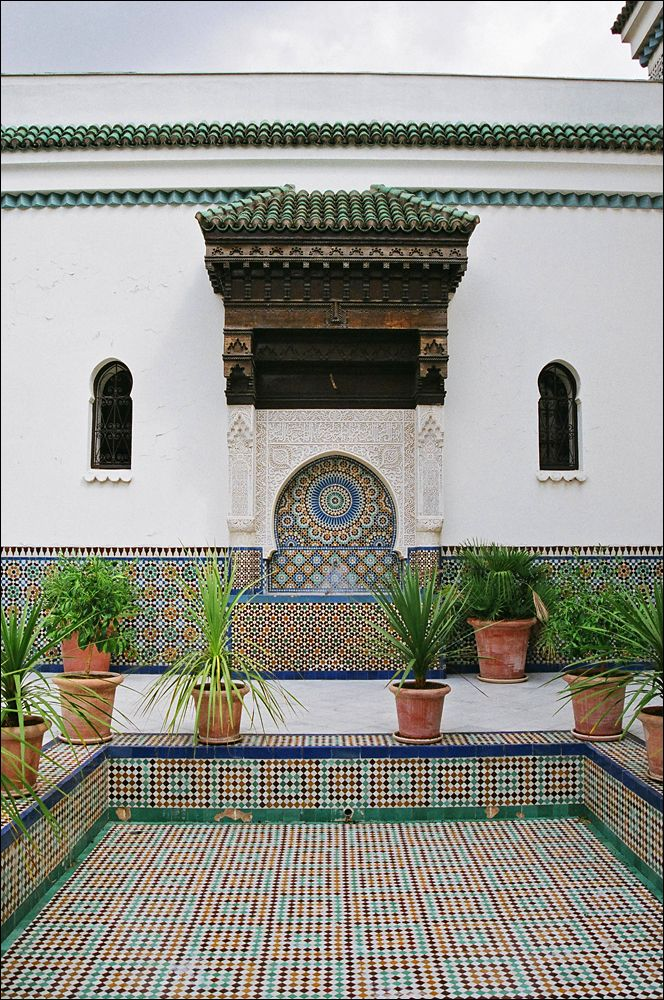"""Grand Mosque of Paris, Paris, France. The Grande Mosquée de Paris is located in the 5th arrondissement and is one of the largest mosques in France. Built in Neo-Mudéjar style the mosque was founded in 1926 as a token of gratitude, after WWI, to the Muslim tirailleurs (or """"shooting skirmishers"""") from France's colonial empire. Initially sponsored by the king of Morocco, the mosque was assigned to Algeria in 1957 by the French Foreign Minister. The mosque is currently led by mufti Dalil…"""