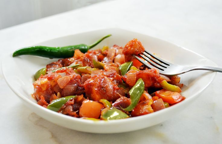 Chilli Paneer, a dish made of cottage cheese cubes sauteed with spring onion and bell pepper, an irresistible starter. #VeganDishes
