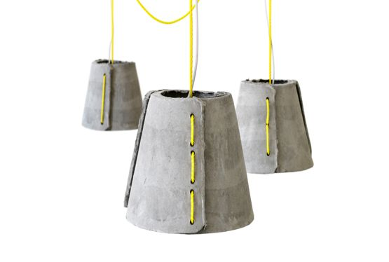 company Eternit-  Rainer Mutsch created a limited series of pendant lights for outdoor use made of hand-molded fiber-cement shells and sailing rope. Fiber-cement is a highly durable, recyclable material made of natural components like cellulose fibers and water and was originally developed as a material for cladding and roof coverings.