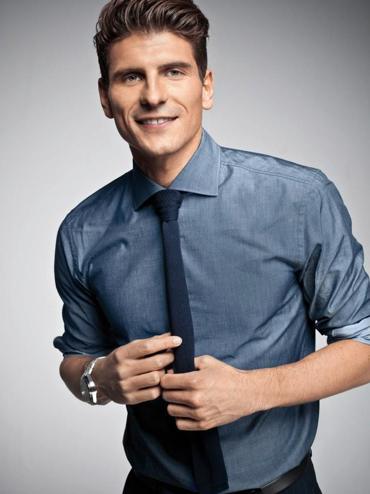 Style beyond the game! German soccer pro Mario Gomez switched his soccer outfit off the field with business styles from BOSS Black.