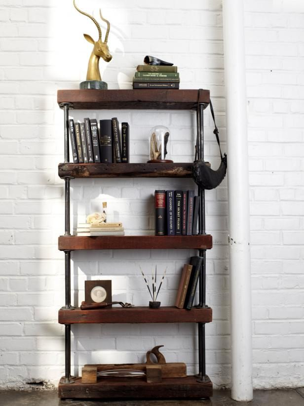 Combine reclaimed wood and galvanized black pipe to create a rugged bookshelf that adds texture and warmth to any room.