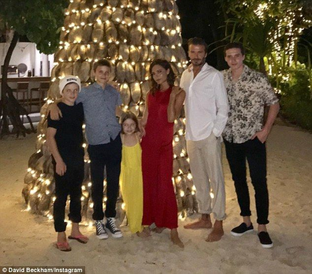 'Happy new year everyone!' David shared a rare snap of Victoria, Brooklyn, Romeo, Cruz and...