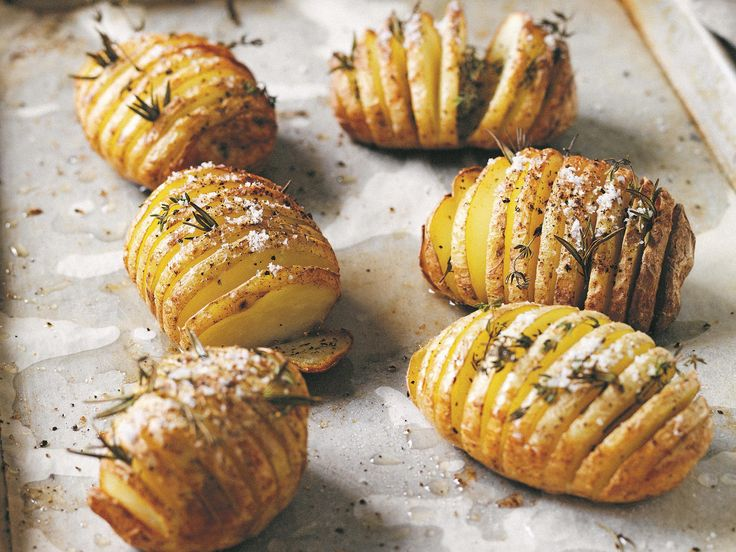 """While the garlic and rosemary certainly add to the flavour to these beautifully crispy potatoes from Manu Feildel's cookbook, ['More Please!'](https://www.murdochbooks.com.au/browse/books/tv-celebrity-chefs/More-Please-Manu-Feildel-with-Clarissa-Weerasena-9781743368459