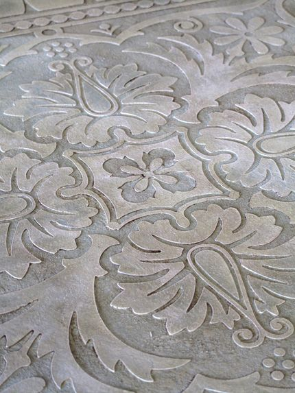 Stenciled plaster for table tops... can totally see this on my little tables, in a much more subtle application.