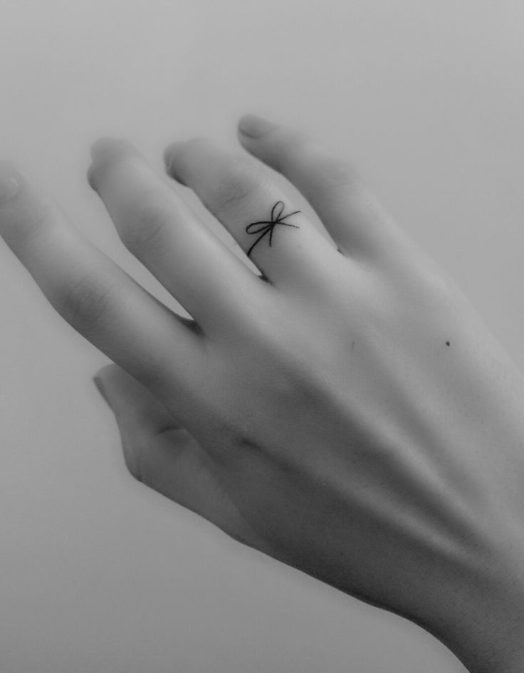 My tiny tattoo! Ribbon finger small tattoo http://tattoopictures.org/black-grey-tattoos/