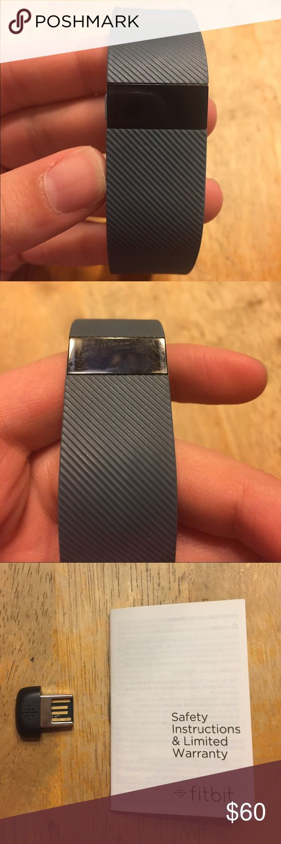 Fitbit Charge, Slate Grey, Large This is a Fitbit Charge (NOT an HR!) in the color Slate Grey and it is in size Large. It is in very good condition, and this is because it wasn't used for very long. It does have scratches on the screen but nothing too noticeable and the button works well. It comes with the wireless sync dongle and the manual, but no charger because it got lost. It no longer has the 1 year warranty since it was bought over a year ago. I'm sorry that I cant accept a trade, but…