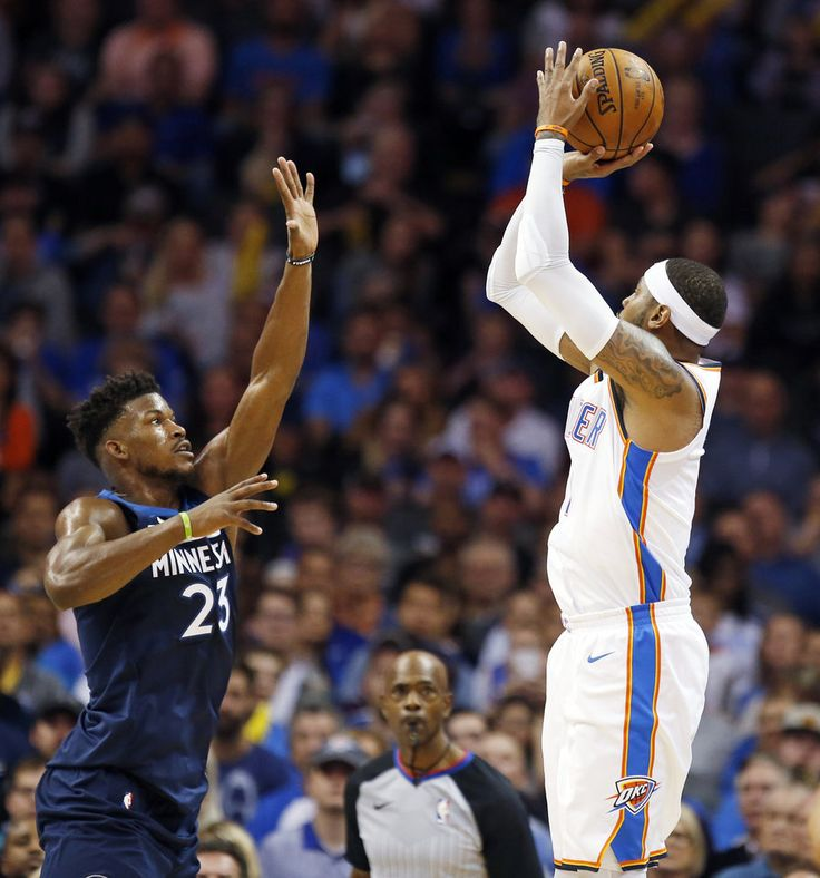 Oklahoma City's Carmelo Anthony (7) shoots against Minnesota's Jimmy Butler (23) during an NBA basketball game between the Oklahoma City Thunder and the Minnesota Timberwolves at Chesapeake Energy Arena in Oklahoma City, Sunday, Oct. 22, 2017. Minnesota won 115-113. Photo by Nate Billings, The Oklahoman