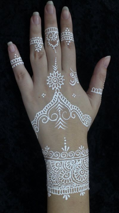 White Henna hand decoration