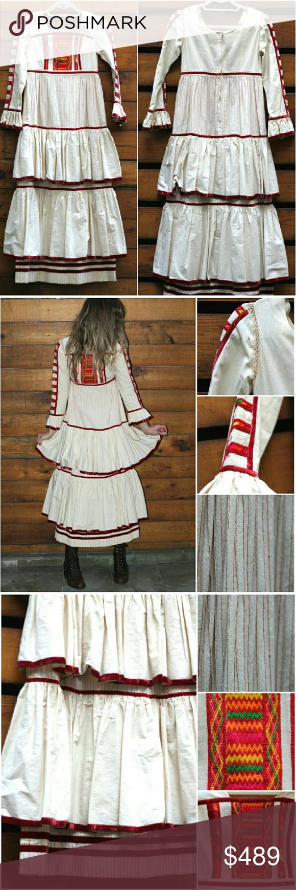 """Vintage 70s Boho Hippie Mexican Folk Art Dress Most incredible work of art dress w/ exquisite details  Stunning Embroidery - velvet piping - ruffle tiers at skirt & wrist -sturdy fabric back zip Disenado con carino por Georgia Charuhas - dry clean. Est size xs/s -was a lil snug around the bust/back area on the model (32d) meas below.  Has a some pale tea colored stains on the ivory fabric- couple on the sleeve, one near the colored patchwork section of the bodice. One 1/4"""" rust colored stain…"""