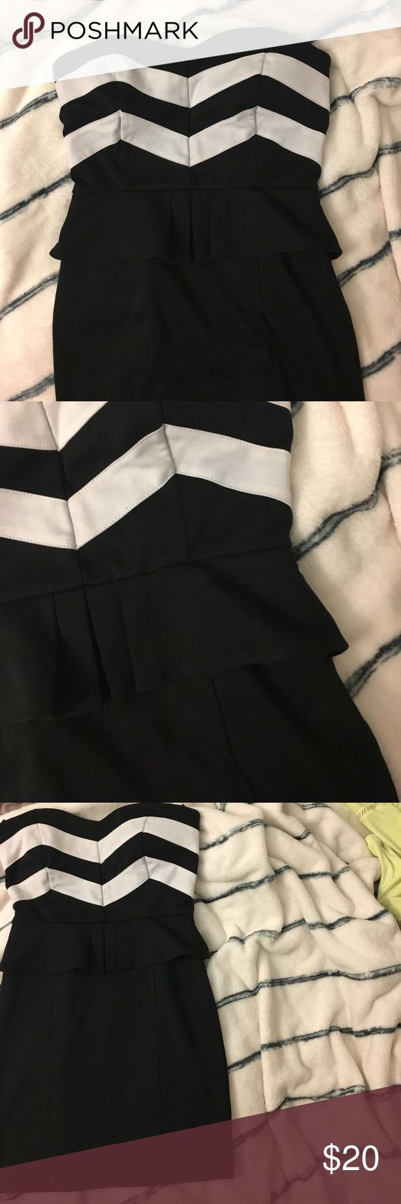 Black and white mini dress Mini dress with black and white chevron design. Fits like a peplum dress. Work only a couple of times. Forever 21 Dresses Mini