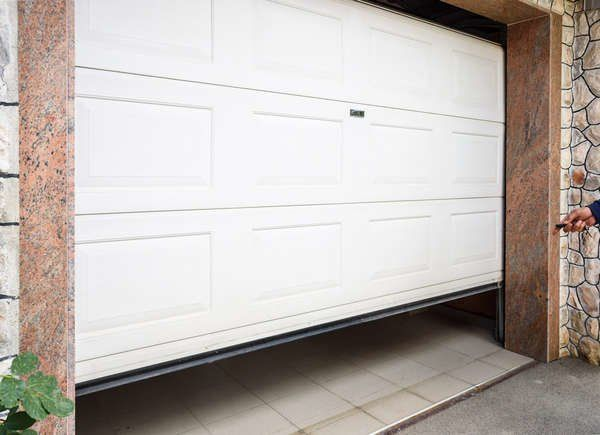 The Most Important Outdoor Tasks You Can Complete This Summer With Images Garage Doors Door Repair Updating House