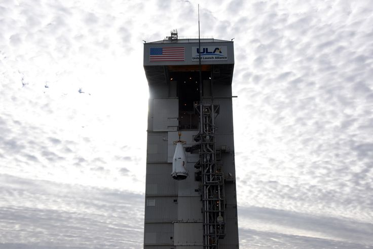 A 4-meter payload fairing, with the NROL-79 mission encapsulated inside, is mated to an Atlas V booster inside the Mobile Service Tower or MST at Vandenberg Air Force Base's Space Launch Complex-3.