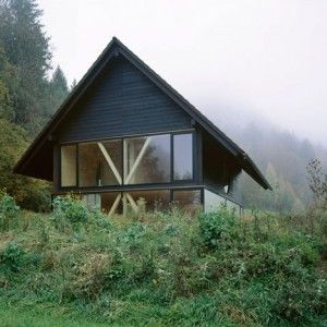 Pascal Flammer's House in Balsthal features  wooden braces and a circular window