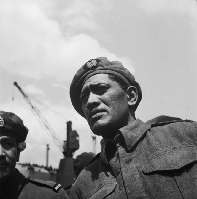 Joseph Takuta, of the Maori Battalion, on his return from service during World War II. Photographed by John Dobree Pascoe, circa 1944.
