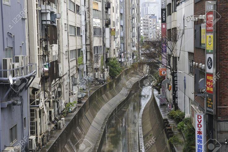 Tokyo, Japan -April 23, 2011 : Narrow Concrete Water Channel.. Stock Photo…