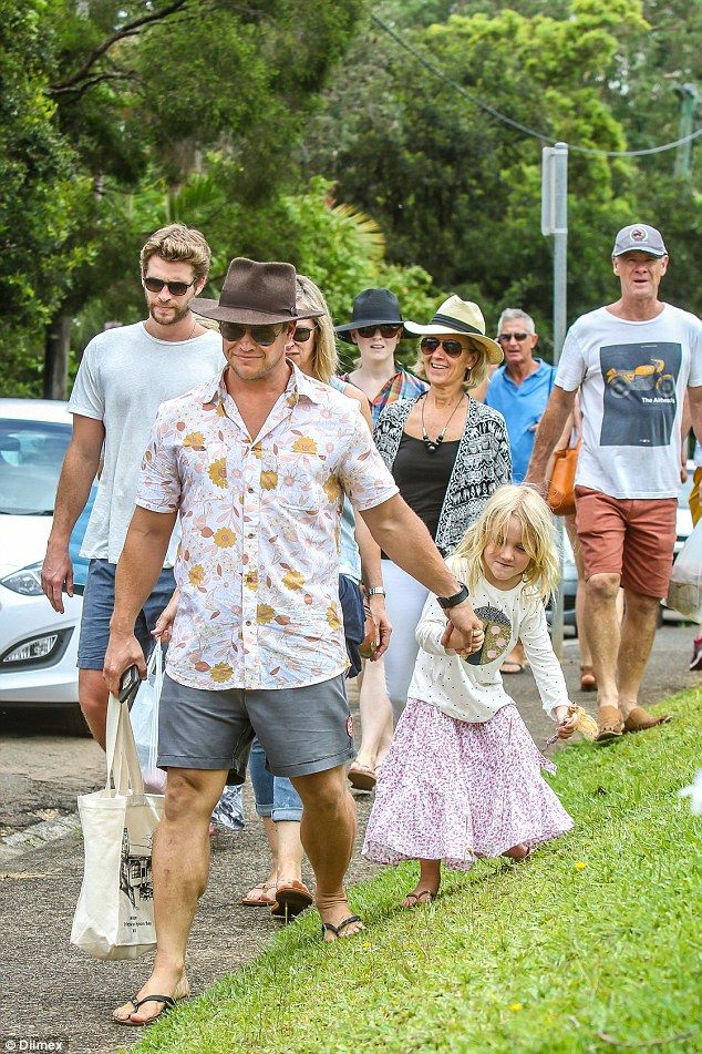 The Hemsworth brood: Eldest brother Luke Hemsworth and his daughter lead the way as the family walked along a quiet Byron Bay street