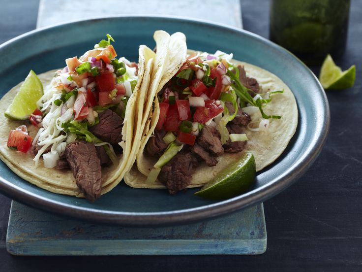 Tyler Florence's version of his 5-star tacos carne asada use two jalapenos and a heaping of garlic--but you can make them as hot as you want.