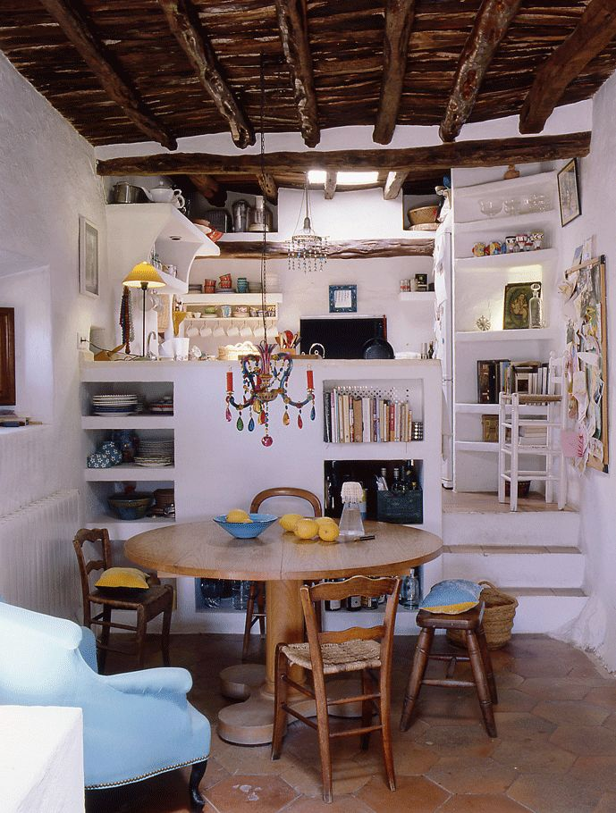 Ibiza, Spain adobe home // love this compact kitchen, with everything in its place...adorable chandelier