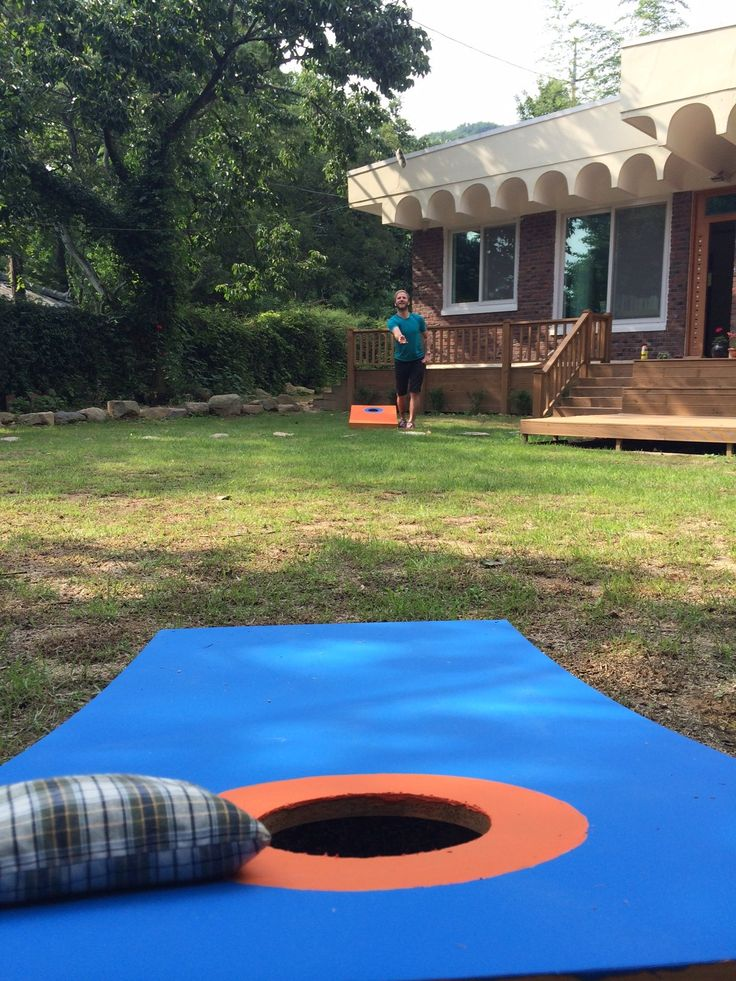 Playing cornhole in the front yard!