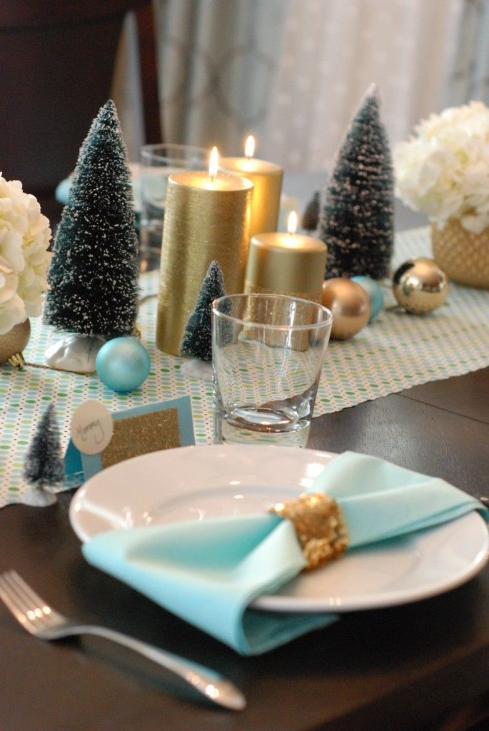 Gold and blue table accents for a holiday themed wedding reception - so cute