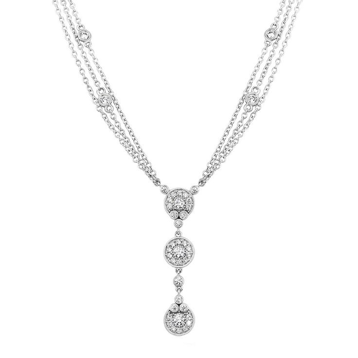 """The quintessential statement with radiant simulated diamonds featuring the halo button design and """"diamonds by the yard"""" strands."""