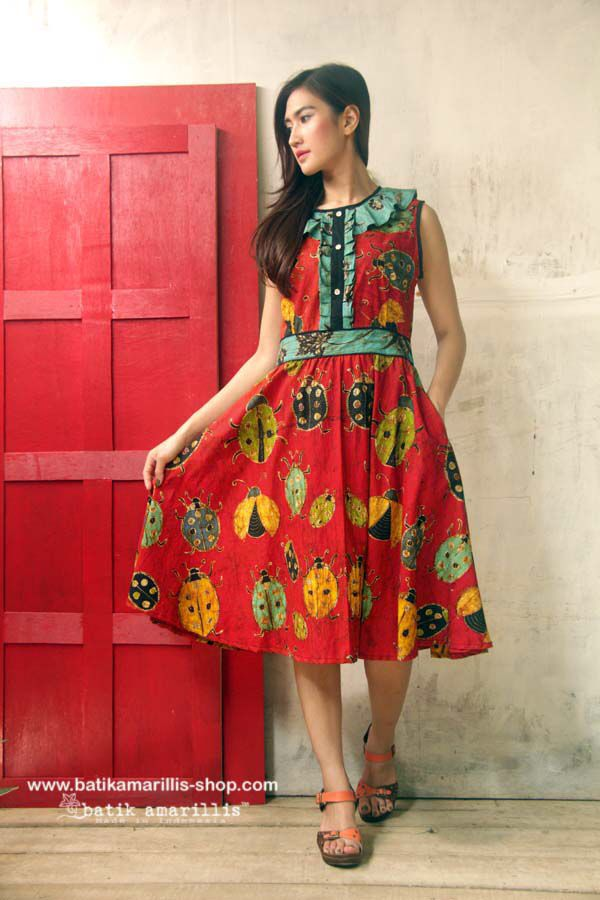 Batik Amarillis's Romancia dress Tap into Batik Amarillis's ultra-feminine aesthetic with this frill and bell sleeved dress, cut to 1950 and 1960s-inspired silhoutte, the bodice is accented with vertical frill while full skirt add the drama to the dress