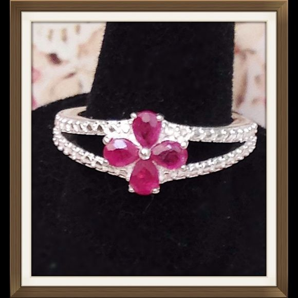 Adorable Natural Ruby Ring New genuine natural Ruby ring features pear cut gems to form a flower design. Double open shank design. Set in .925 Sterling Silver nickel free. Size 7, TGW .88 Cts. So sweet. Jewelry